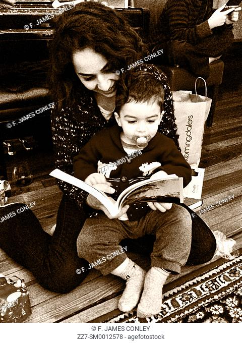 A mother reads to her son