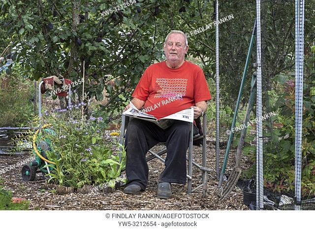 Plot 8, Gus Bothwell reading his newspaper a Eglinton Growers allotments, Kilwinning, Ayrshire, Scotland