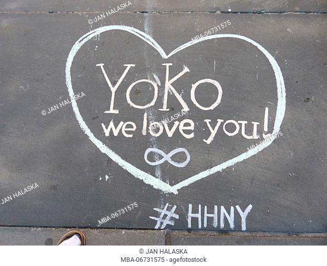 Chalk drawn heart on NYC sidewalk 'Yoko, we love you!' sign, praising Yoko Ono