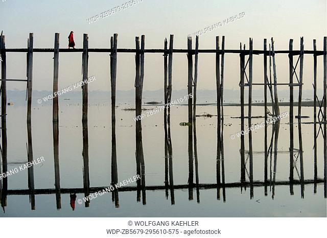 U Bein Bridge (built around 1850 and is believed to be the oldest and longest teakwood bridge in the world) reflecting in Taungthaman Lake near Amarapura