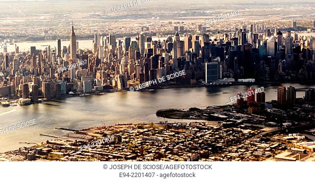 Aerial view of New York City from an airplane showing the East River, Brooklyn, mid-town Manhattan
