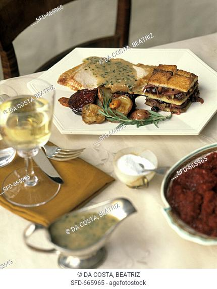 Thanksgiving plate with slices of roast turkey & accompaniments