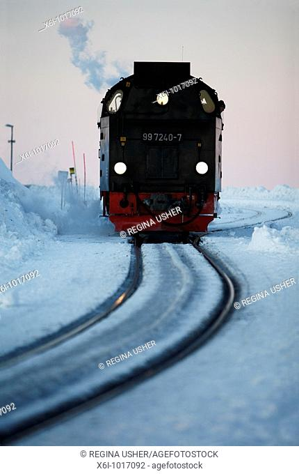 Steam train arriving at top of Brocken mountain in evening, Hochharz National Park, Sachsen-Anhalt, Germany
