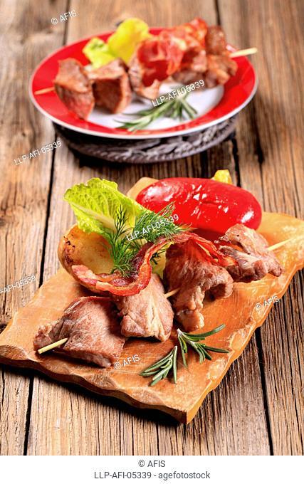 Venison souvlaki and bacon strip