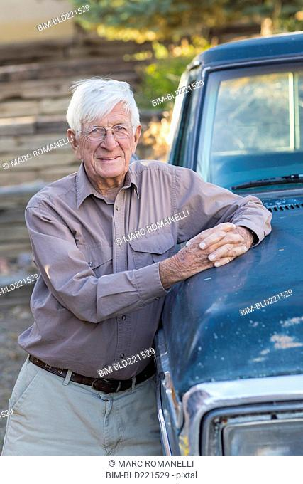 Older Caucasian man standing at truck