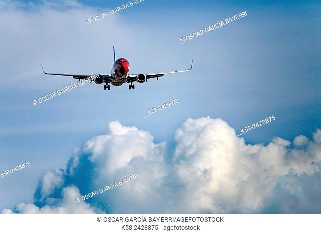 Airplane approaching land and storm clouds. Barcelona. Spain