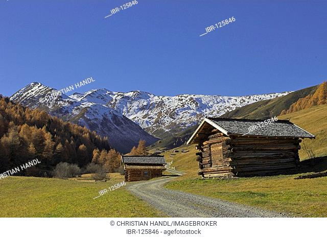 Wooden huts in the Vallung valley (end of the Rojen valley), Rojen, South Tyrol, Italy