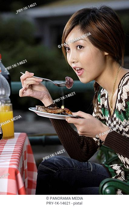 Young woman eating food