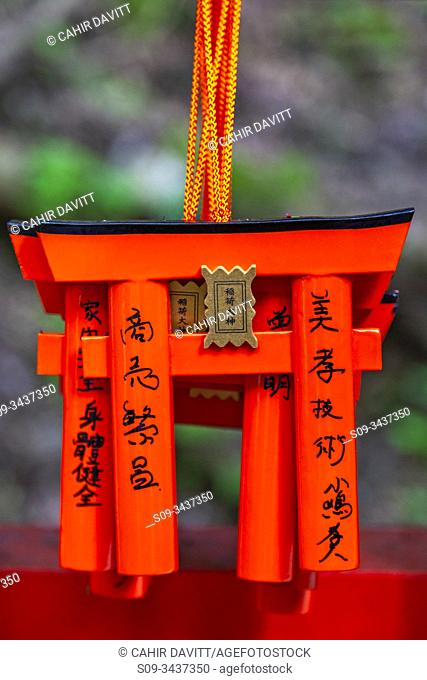 Mini torri gate pendants hang in the Osugisha Shrine in the Shinto Fushimi Inari Taisha Shrine, Fukakusa, Shimoseya, Kyoto Fu, Japan