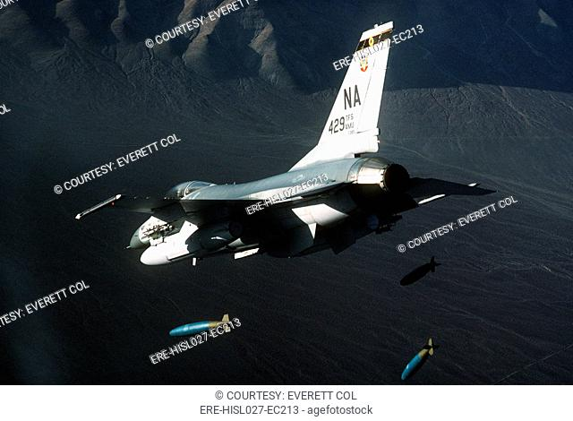 F-16 Fighter releasing three 2000-pound bombs. Feb 1 1987. BSLOC-2011-12-220