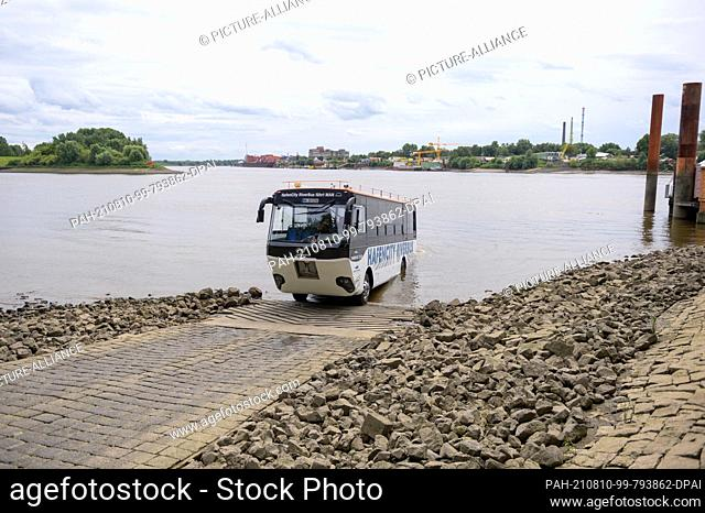 09 August 2021, Hamburg: The Hafencity Riverbus stands in the water of the Elbe at the slipway in Entenwerder during a technical inspection