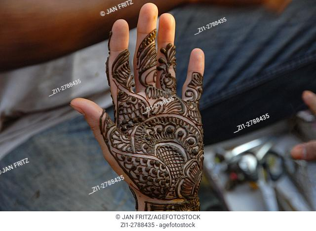 Hand with newly done henna patterns