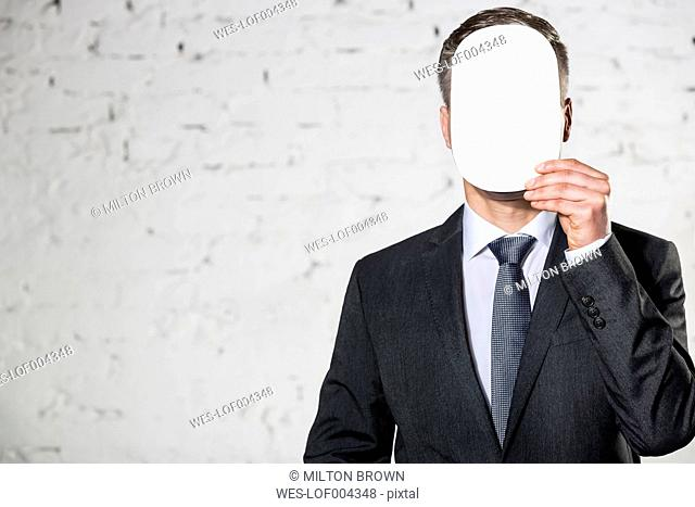 Businessman covering his face