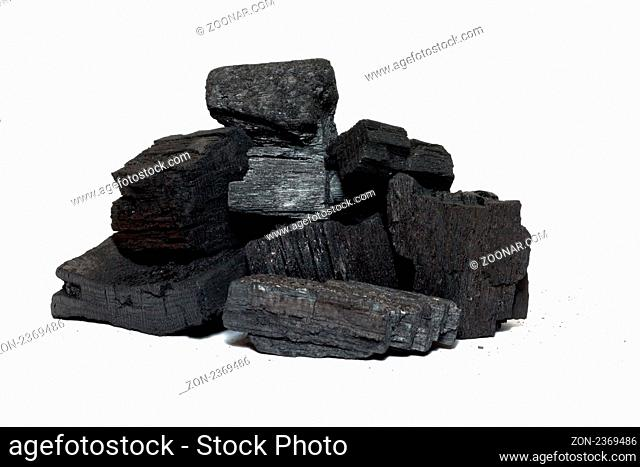 Bits of charcoal prepared to burn isolated on white