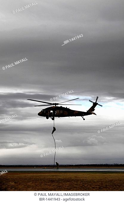 Military aircraft, Australian army troops sliding down a rope from a Black Hawk helicopter