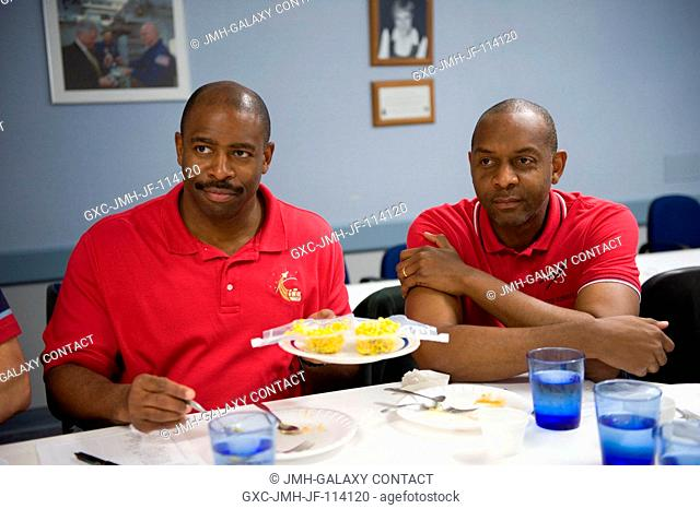 Astronauts Leland Melvin (left) and Robert Satcher, both STS-129 mission specialists, participate in a food tasting session in the Habitability and...