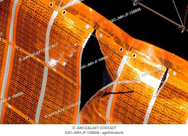 One of a series of images of a two-foot tear in solar array material downlinked by the STS-120 crewmembers just a few hours prior to a two-person spacewalk...