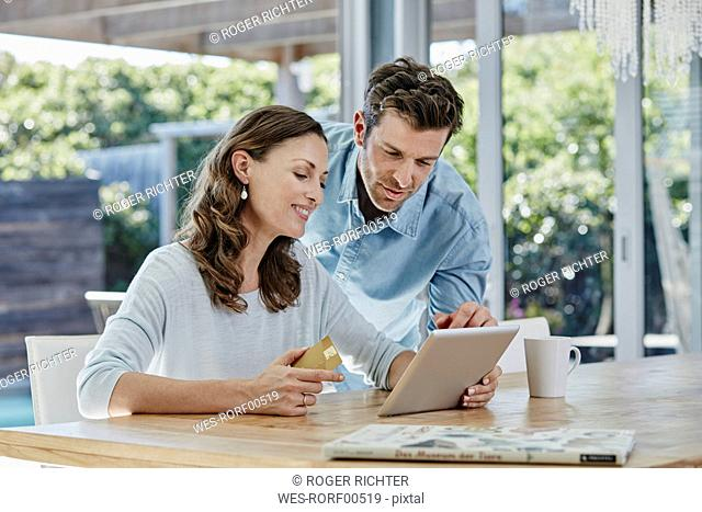 Couple doing online payment with credit card