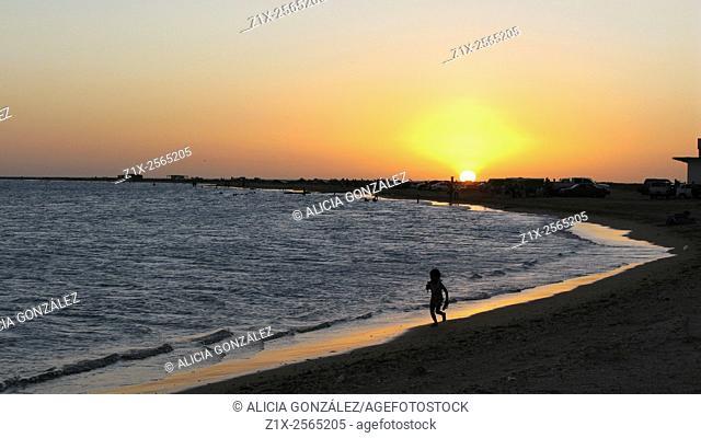 Litle girl run in a beach, Península de Paraguaná, Falcon state, Venezuela