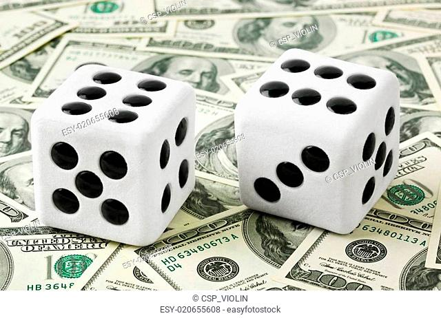 Two dices on money background