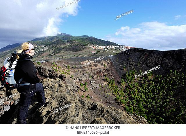 Woman on the crater rim of the San Antonio Volcano near Fuencaliente, overlooking Los Canarios, La Palma, Canary Islands, Spain, Europe, PublicGround