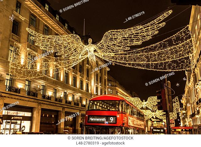 Street Christmas decoration in Regent Street December 2016 with red busses, lighting angels