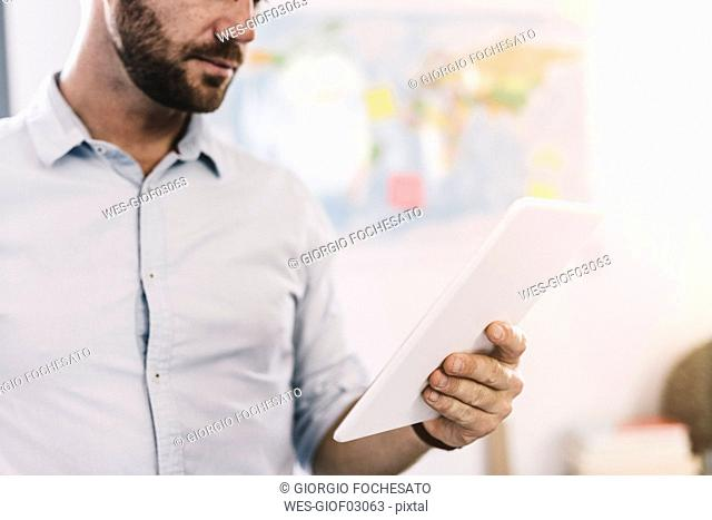 Businessman using tablet, partial view