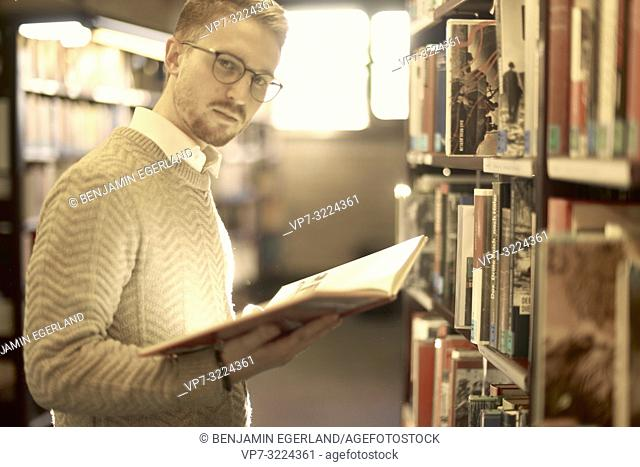 man holding book, library, glasses, student, university, knowledge