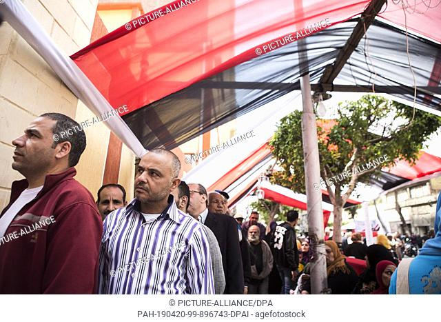 20 April 2019, Egypt, Cairo: Men stand in lines to take part in the first day of the national referendum on the constitutional amendments extending the...
