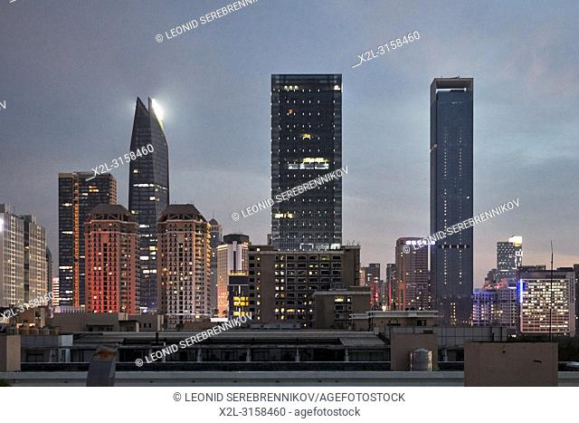 High-rise buildings in Futian District illuminated at dusk. Shenzhen, Guangdong Province, China