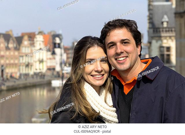 Portrait of couple by Leie river, Ghent, Flanders, Belgium