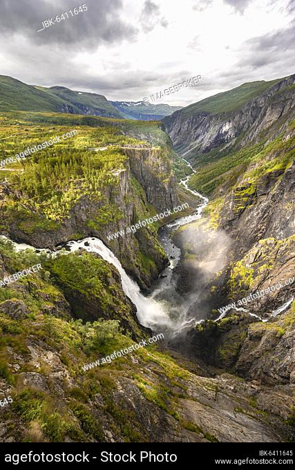 View into the river valley with waterfall Vøringfossen, river Bjoreio falls down a rock face, valley with river, Eidfjord, Norway, Europe