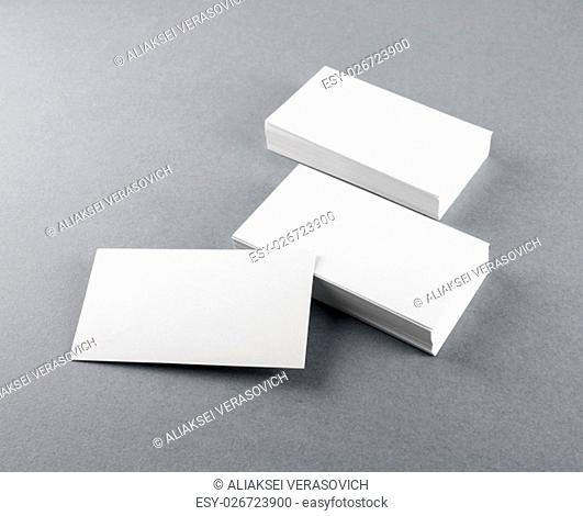 Photo of blank business cards with soft shadows on gray background. Template for branding identity