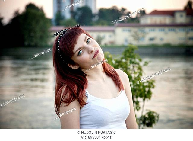 Portrait of young woman with hair clip outdoors