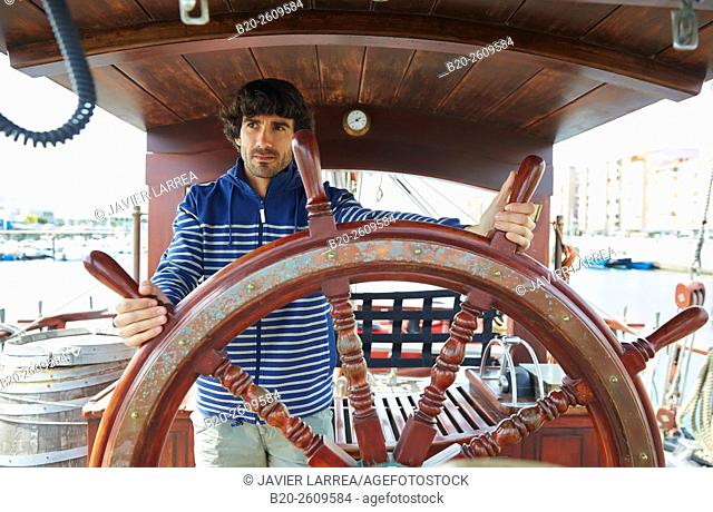 Sailor at the helm of a sailboat, galleon. Basque Country. Spain