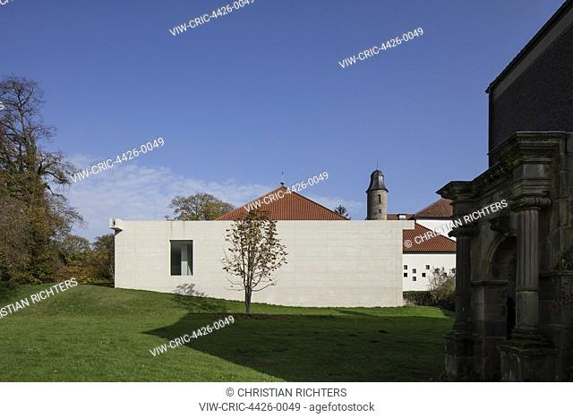 Contextual view with church's perimeter wall. Church Hardehausen - Jugendkirche Hardehausen, Hardehausen, Germany. Architect: Schilling Architekten, 2017