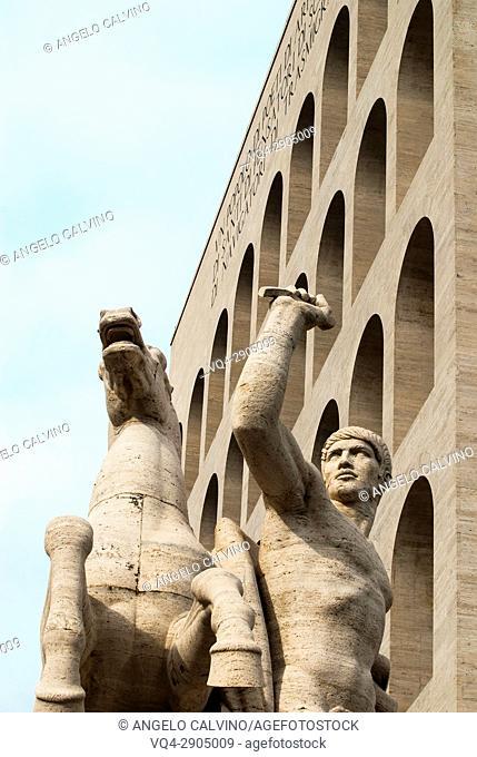 Statue of a Horse and a Man in front of Palazzo della Civiltà Italiana, Colosseo Quadrato, EUR, Expo, Rome, Italy, Esposizione Universale