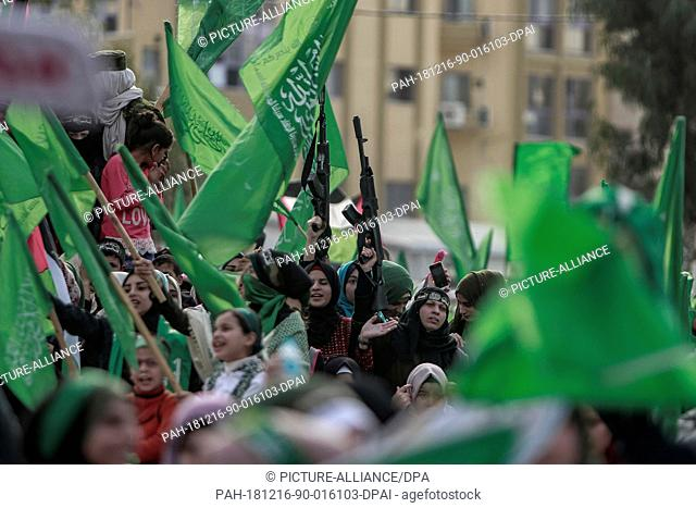 16 December 2018, Palestinian Territories, Gaza City: Palestinian women hold up weapons as they take part in a rally marking the 31st anniversary of the...