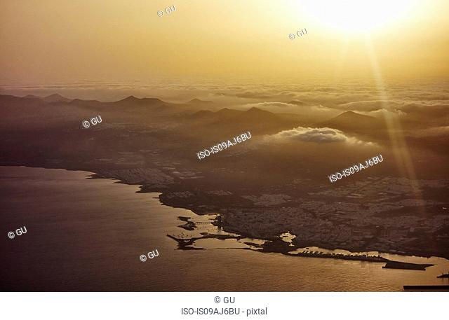 Aerial view of Lanzarote coastline at sunset, Canary Islands, Spain