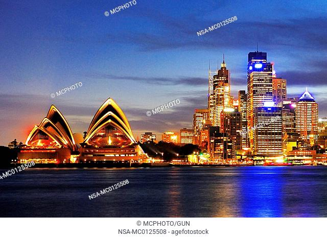 Skyline of Sydney with Sydney Opera and luxury liner Queen Mary 2 during the blue hour, Circular Quay, Sydney Cove, Sydney, New South Wales, Australia