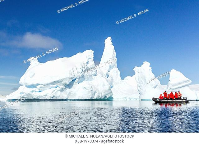 Guests from the Lindblad Expedition ship National Geographic Explorer enjoy the Yalour Islands, Antarctica by Zodiac