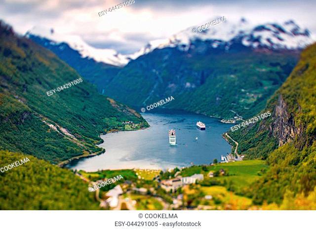 Geiranger fjord, Beautiful Nature Norway (tilt shift lens). It is a 15-kilometre (9.3 mi) long branch off of the Sunnylvsfjorden