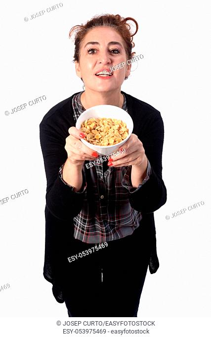 woman with a bowl of cornflakes on white background