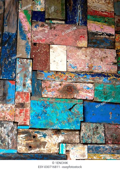 Grunge painted wooden blocks old wall in Bali style