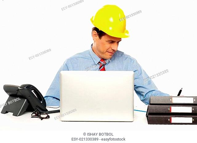 Young architect actively working at his desk