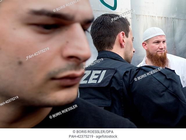 The radical Islamic preacher Pierre Vogel (R) appears at a demonstration in Frankfurt/Main, Germany, 07 September 2013. The rally officially announced as...