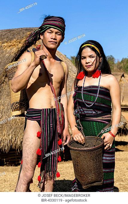 Phnong man and woman in traditional costume, ethnic minority, Pnong, Bunong, Senmonorom, Sen Monorom, Mondulkiri Province, Cambodia