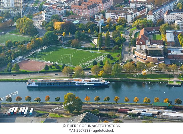 France, Bas Rhin 67, Strasbourg, Bassin des Remparts, Rhine canal with river cruise boat aerial view