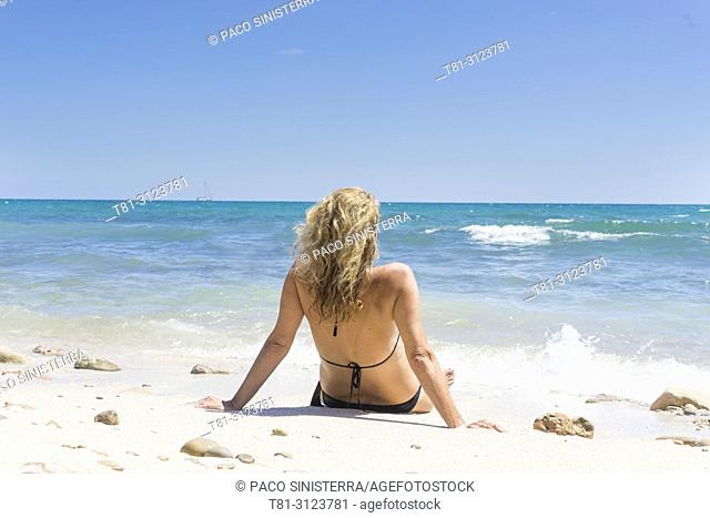 girl lying on the beach, Alcocebre, Castellon, Spain