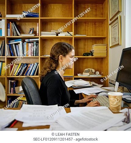 View of woman working in office